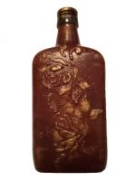 декоративная бутылка ручной работы в технике объемного декора. Декор выполен акриловой шпаклевкой. Бутылка может использоваться по назначению или как предмет декора интеръера