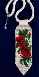 Галстук ручной работы. Выполнен из ческого бисера на титановой нити. Использовано станочное ткачество и плетение бисерного жгута. Станет прекрасным дополнение даже к деловой блузе, особенно если вам нужно быть одетым в украинском стиле.