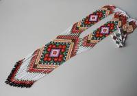 """Гердан """"Кольоровий"""". Гердан є однією з найстаріших жіночих прикрас.  Це універсальна прикраса, чудово підходить жінкам любого віку.  Виконаний в техніці """"верстатне ткацтво"""" з чешського бісеру. Довжина виробу з бахромою 59 см., ширина центрального елемента 7,5 см."""