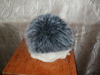 """Зимняя теплая женская шапка, связанная спицами из меховой пряжи """"чернобурка"""" на двойной подкладке."""