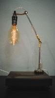 """Настільна лампа """"Pride&Joy"""", виготовлена з авто-деталей, металу і натурального дерева, в стилі """"Loft"""" з лампою Едісона. Ручна робота з індивідуальним дизайном. Встановлено диммер для регулювання яскравості світла на будь-який смак.  особливості: - З унікальних авто-деталей і натурального дерева; - Встановлено диммер; - Довжина шнура - 150 см .; - Стандартний патрон; - Лампа Едісона входить в комплект;  Основа: 24 cm x 15 cm x 5 cm Висота: max 52 cm Вага: 2 kg  Дану модель можна виготовити під замовлення в необхідній кількості. Авто-деталі можуть відрізняться від заявлених на фото."""