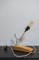 """Настільна лампа """"Pride&Joy"""", виготовлена з авто-деталей, стали і натурального дерева, з лампою Едісона. Ручна робота з індивідуальним дизайном. Встановлено димер для регулювання яскравості світла на будь-який смак.  особливості: - З унікальних автодеталей і натурального дерева; - Встановлено димер; - Довжина шнура - 150 см .; - Стандартний патрон; - Лампа Едісона входить в комплект;  Основа: 24 cm x 8 cm x 4 cm Висота: 32 cm Вага: 1 kg  Дану модель можна виготовити під замовлення в необхідній кількості. Авто-деталі можуть трохи відрізняться від заявлених на фото."""