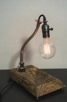 """На замовлення. Термін виготовлення: 5-7 робочих днів.  Настільна лампа """"Pride&Joy"""", виготовлена з авто-деталей і натурального дерева, з лампою Едісона. Ручна робота з індивідуальним дизайном. Встановлено димер для регулювання яскравості світла на будь-який смак.  особливості: - З унікальних автодеталей і натурального дерева - Встановлено димер; - Довжина - 150 см.; - Стандартний патрон; - Лампа Едісона входить в комплект;  Основа: 25 cm x 15 cm x 3 cm Висота: 35 cm Вага: 2 kg  Дану модель можна виготовити під замовлення в необхідній кількості. Авто-деталі і шия можуть трохи відрізнятися від заявлених на фото."""