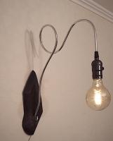 """Настінний світильник """"Pride&Joy"""", виготовлений з авто-деталей, стали і натурального дерева з лампою Едісона. Ручна робота з індивідуальним дизайном. Встановлено димер для регулювання яскравості світла на будь-який смак.  особливості: - З унікальних автодеталей і натурального дерева; - Встановлено димер; - Стандартний патрон; - Лампа Едісона входить в комплект;  Висота - 47 cm, глибина - 34 cm. Основа - 29 cm. висотою.  Дану модель можна виготовити під замовлення в необхідній кількості. Авто-деталі можуть трохи відрізнятися від заявлених на фото."""