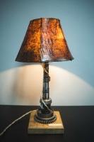 """Настольная лампа с абажуром """"Pride&Joy"""", изготовлена из авто-деталей, метала и натурального дерева, в стиле """"Industrial"""". Ручная работа с индивидуальным дизайном.  Особенности: - Из уникальных автодеталей и натурального дерева; - Все детали очищены и обработаны; - Длина шнура - 150 см.; - Стандартный патрон; - Лампа входит в комплект;  Данную модель можно изготовить под заказ в необходимом количестве. Может быть отличие в деталях ножки. Абажур, также, можно подобрать индивидуально."""