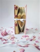 """Этим необычным подарком вы покорите сердце виновницы торжества !  Есть такое крылатое выражение """" Книга - лучший подарок"""". Звучит как -то уж очень обыденно ...  но такой книгой вы сможете удивить ! И могу поспорить ,что такой книжки точно нет у ваших знакомых и друзей. А кому же не хочется иметь в доме оригинальную и интересную вещицу?  Я думаю ,что глядя на такой подарок она каждый раз будет улыбаться и вспоминать о вас . В каждую свою работу я вкладываю частичку своей души и хорошего настроения, занимаюсь изготовлением сувениров с огромной радостью, и надеюсь, что  радость попадет с этим подарком и в дом того человека, которому вы его преподнесёте . Материалы из которых изготовлен сувенир  :  книжка, винтажное кружево,розочки из атласных лент,атласные ленточки,хлопковая ткань,клей. Книга не новая,а винтажная,имеет свою историю, поэтому на ней могут быть потертости, небольшие пятнышки, что придаёт подарку особый шарм"""