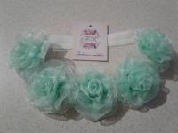 Можливе виготовлення під замовлення у будь-яких кольорах. Трояндочки виготовлені з органзової стрічки.