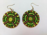 Сережки ручної роботи з полімерної глини в етнічному стилі. Діаметр сережок складає 40 мм