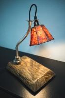 """На замовлення. Термін виготовлення: 5-7 робочих днів.  Настільна лампа з абажуром """"Pride&Joy"""", виготовлена з авто-деталей і натурального дерева. Ручна робота з індивідуальним дизайном. Встановлено димер для регулювання яскравості світла на будь-який смак.  особливості: - З унікальних автодеталей і натурального дерева; - Встановлено диммер; - Довжина шнура - 150 см .; - Стандартний патрон; - Лампа входить в комплект;  Основа: 25 cm x 15 cm x 3 cm Висота: 35 см Вага: 2 kg  Дану модель можна виготовити під замовлення в необхідній кількості. Авто-деталі і шия можуть трохи відрізняться від заявлених на фото. Абажур, можна підібрати індивідуально."""