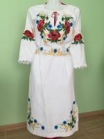 Платье пошито на домотканом льне , машинная вышивка гладью . Цена указана за р. 42 .